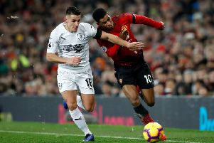 """Burnley's Ashley Westwood (left) and Manchester United's Marcus Rashford battle for the ball during the Premier League match at Old Trafford, Manchester. PRESS ASSOCIATION Photo. Picture date: Tuesday January 29, 2019. See PA story SOCCER Man Utd. Photo credit should read: Martin Rickett/PA Wire. RESTRICTIONS: EDITORIAL USE ONLY No use with unauthorised audio, video, data, fixture lists, club/league logos or """"live"""" services. Online in-match use limited to 120 images, no video emulation. No use in betting, games or single club/league/player publications"""
