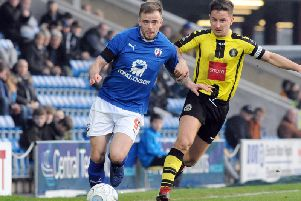Lee Shaw on the move for Chesterfield.