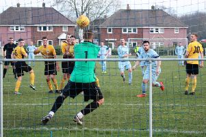 Thorne goalkeeper Richard Watson fails to hold a powerful strike from hat-trick hero Ant Lynam.