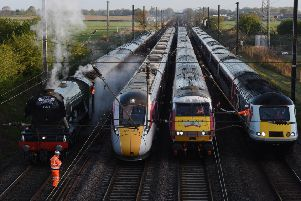 New trains planned for the East Coast mainline do not work properly with track-side equipment, it has emerged. The Azuma trains (pictured, second left) cause electromagnetic interference to older signals and points in the north of England. This means the electro-diesel trains can only run on diesel, travelling much more slowly than their promised speed. Network Rail said it was working with Japanese train manufacturer Hitachi to fix the problem but it was too early to identify a solution.  FILE PICTURE - A Virgin Azuma Class 800 train (second left) side-by-side with The Flying Scotsman, an InterCity 225 Class 91 and a HST Class 43.