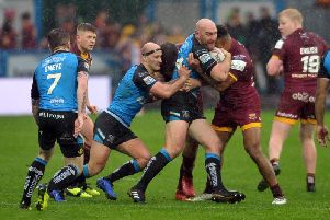 Hull FC's Gareth Ellis - playing his second game back from retirement - takes it into Huddersfield (PIC: Tony Johnson)