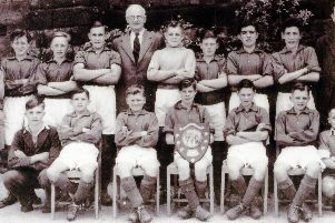 Members of the Lea and Holloway School football team after winning the South Peak Shield in 1950.