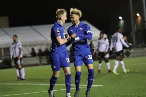 Alex Kiwomya, right, congratulates Scott Boden on his fifth goal in eight games for Chesterfield