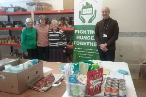 Alnwick Foodbank volunteers Jean Findlay, Marlene Gray, Carol McRoberts with NCC representative and the manager of Northumberland Adult Learning, based at Lindisfarne, Michael Holliday.