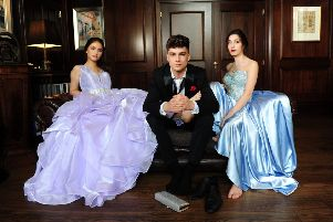Hannah, left, wears lilac ruffle ball gown with rhinestone waistband, from �299, Eternity Prom by Eternity Bridal. Harvey wears: The Britannia tuxedo, �130; Britannia trousers, �69; shirt, 325; bow tie, �10. All at Johnny Tuxedo. Millie wears sweetheart strapless with rhinestone beaded bodice, from �299, Eternity Prom for Eternity Bridal. At Bowcliffe Hall, Bramham. Picture by Simon Hulme; Styling by Stephanie Smith