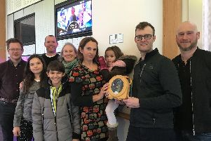 From left to right, Josh's friends Steven Johnson and Nick Wilson, with Josh's family - daughter Amelie, son Benjy, mum Susan, widow Chloe holding daughter Naomi, and Josh's friends, Matt Evans, programme manager at The Grand, and Daniel Burke.