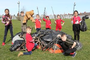 Gracie, Charlie, Cindy, Oliver, Harrison, Scarlett, Taylor and Asaria with the collected rubbish. Pictures by Jason Chadwick.