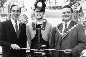 The mayor has a go on the drum at an Alfreton Fun Day event in the early 1990s.