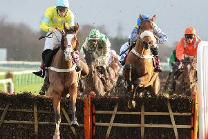 Cornerstone Lad and Billy Garritty (left) winning at Haydock last December. Photo: Jockey Club Racecourses.
