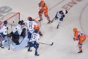 Jonathan Phillips, far right, fires home Sheffield Steelers' fifth  goal against Milton Keynes Lighntning on Saturday night. Picture: Dean Woolley.