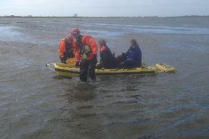 Firefighters soon arrived and launched a water rescue mission using an inflatable sledge to reach the women. Pic - Chris Kelly and Peter Kenworthy
