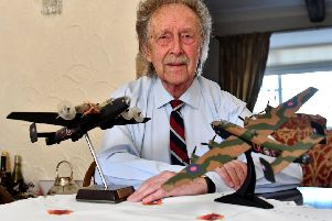 Alan Mitcheson with models of the Halifax bomber.
