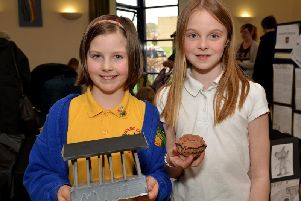 Pictured are Darcie, eight and Lexi, nine with their exhibits.