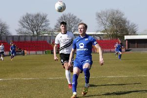 Chesterfield's Scott Boden and Gateshead's Jon Mellish battle for the ball.