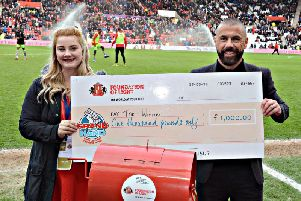 Lottery Coordinator  Suzanne Campbell and former SAFC star Kevin Phillips perform the half time draw