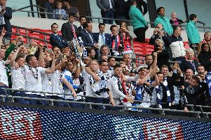 Preston North End players lift the League One play-off final trophy at Wembley in 2015