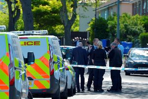 Police at the scene on Friday. Photo - SWNS