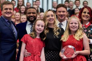Great Longstone choir Perfect Pitch is celebrating after winning the Songs of Praise Young Choir of the Year 2019. Musical director Emma Hopkins, centre, with performers and judges.
