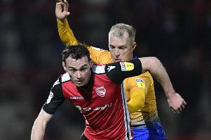 Mansfield Town's Neal Bishop tussles for the ball with Morecambe's Liam Mandeville :Picture by Steve Flynn/AHPIX.com, Football: Skybet League 2  match Morecambe -V- Mansfield Town at Globe Arena, Morecambe, Lancashire, England on copyright picture Howard Roe 07973 739229