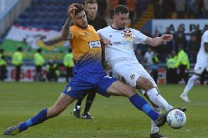Mansfield's Ryan Sweeney battles with Newport's Padraig Amond in the play-off semi-final finale.