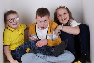 Jack Mangan (centre) with his six-year-old brother Josh and sister Georgia, nine.
