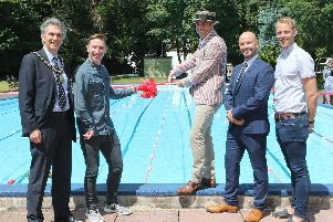 From left, Mayor David Hughes, Paralympian Ryan Taylor, pool attendant Jason Skipper, hotel manager Richard Devine, and former Commonwealth champion Ross Davenport.