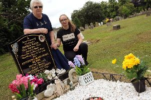 Pamela Wain with her granddaughter, Holly Symour, at her daughter Maria's grave. Pic: Anne Shelley.