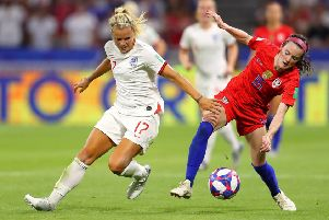 LYON, FRANCE - JULY 02: Rose Lavelle of the USA is challenged by Rachel Daly of England during the 2019 FIFA Women's World Cup France Semi Final match between England and USA at Stade de Lyon on July 02, 2019 in Lyon, France. (Photo by Richard Heathcote/Getty Images)