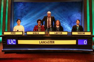 Lancaster Universitys University Challenge team with host Jeremy Paxman
