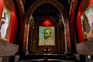 """Date: 8th July 2019.'Picture James Hardisty.'A new exhibition the Van Gogh The Immersive Experience has opened in the former church, York St Mary�""""s located in Castlegate, York. The UK premiere provides a new perspective on Van Gogh�""""s work, taking the original paintings and projecting them onto walls, screens and even the roof of the building, but with a twist - wheat sways in the breeze, water pours out of the confines of the painting�""""s frame, and stars twirl and swirl in the night sky, as digital animation brings the paintings to life. Pictured Rose Moens, Manager of the Van Gogh, The Immersive Experience, admiring the exhibition."""