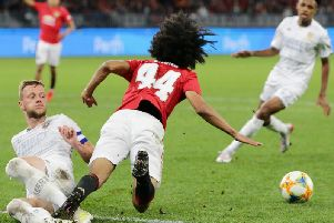 TOO GOOD: Manchester United's Tahith Chong is taken out by Leeds United skipper Liam Cooper in Wednesday's pre-season friendly in Perth. Picture by Will Russell/Getty Images.