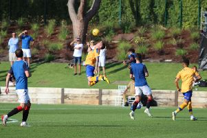 Action from Mansfield's 2-0 defeat to Rangers in a training match in Portugal.