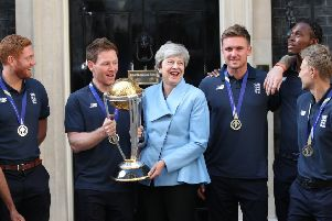 Theresa May on the steps of 10 Downing Street with the cricket World Cup.