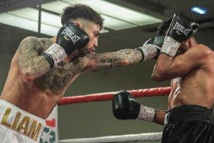 Chesterfield boxer Liam Dring on his way to victory in his first fight as a professional.