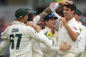 Pat Cummings of Australia celebrates with Steve Smith and team-mates after taking the final wicket of Chris Woakes of England to win the 1st Specsavers Ashes Test between England and Australia at Edgbaston. (Picture: Gareth Copley/Getty Images)