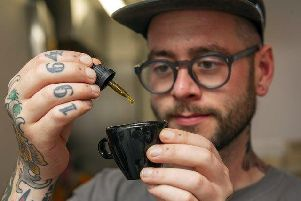Ben Stevenson adds a touch of cannabis to a cuppa at Starbuds.