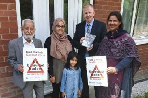 Councillor Mahmood Akhtar, Batley resident Habiban Rajah, Head of West Yorkshire Trading Standards David Lodge and Councillor Habiban Zaman at the new cold calling zone in Wayne Close, Batley.