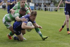 Liam Brown dives for the line in Hunslet Warriors' 28-12 win over Dewsbury Celtic.