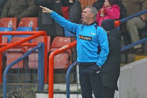 John Sheridan takes his Chesterfield team to Stockport County on Monday.