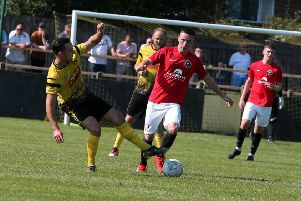 Eastwood's Cal McGarry brushes off a challenge at Hucknall on Monday. Photo by Eric Gregory.