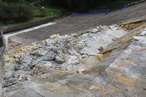 The broken section of the slipway at Toddbrook Reservoir