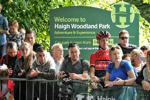 Supporters cheering on the riders at Haigh Hall