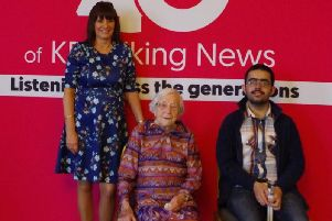 Carole Stump (Chief Librarian atKirkleesLibraries),103 year old Molly James and 20-year-old Zubayr Bhatti.