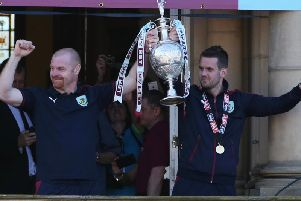 Sean Dyche and Tom Heaton with the Championship trophy in 2016