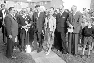 Landmark: A proud day for the old Dewsbury Corporation when the new tenants moved into the 6000th house to be built in Thornhill on Foxroyd Lane. I believe the new tenants were Alfred Lockwood and  his wife Alice, pictured with the Mayor Councillor Wilkinson, and Councillor Hector Nunns, surrounded by officials of the Dewsbury Corporation and watched by interested youngsters. I feel sure the tall gentleman on the right with a moustache was Mr Grace, the head of the Dewsbury housing department.