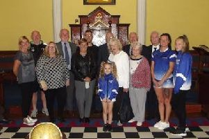 Presentation: Nine Dewsbury charities received cheques totalling �5,000 from St John's Masonic Lodge.