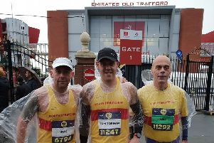 Three of the club's runners, from left, Dean McLaughlin, Tom Topham and Neil Chaplin, outside Old Trafford.