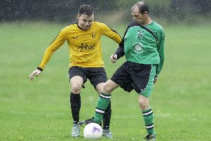 Oliver Rounding (left) scored as Mirfield Town defeated AFC Chickenley 4-2 in the Brook Butler Cup quarter-final last Sunday.