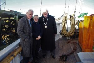 Coun Trevor Thorne, skipper Liz King and Coun Jeff Watson, the civic head of Northumberland County Council, on board the Williams II. Picture by John Tuttiett