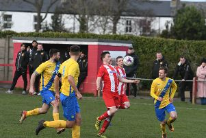Ryhope CW (red/white) v Stockton Town (yellow) at Ryhope CW on Saturday.